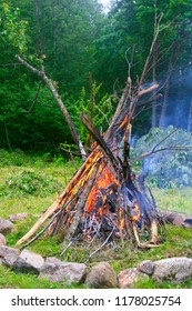Burning branches at the fireplace to celebrate longest day of the year. The Midsummer.