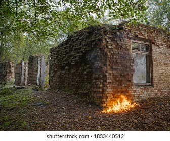 A burning brick building. Fire on the wall.