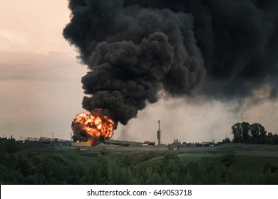 Burning building with flames and black smoke