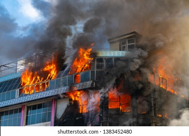 Burning building in thick smoke