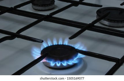 Burning burner of a gas stove close-up. Gas consumption concept