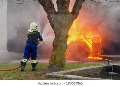 Burning bus hit firefighters