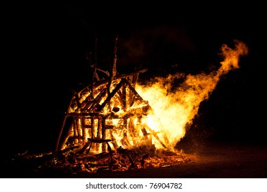 Burning Campfire or bonfire made from logs, shape of a burning house