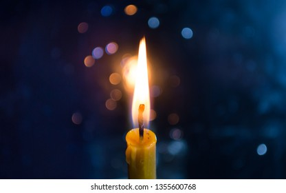 Burning Candle with Bokeh Background
