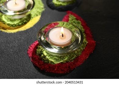 Burning candle for celebration of Divaly on dark background
