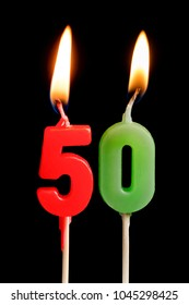Burning candle in the form of 50 fifty figures (numbers, dates) for cake isolated on black background. The concept of celebrating a birthday, anniversary, important date, holiday