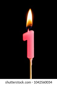 Burning candle in the form of one figures (numbers, dates) for cake isolated on black background. The concept of celebrating a birthday, anniversary, important date, holiday, table setting
