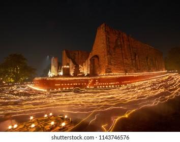 Burning candle lights around at Wat Maheyong, Ayutthaya,Thailand.
