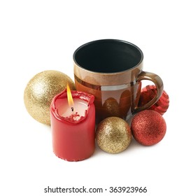 Burning candle next to the mug