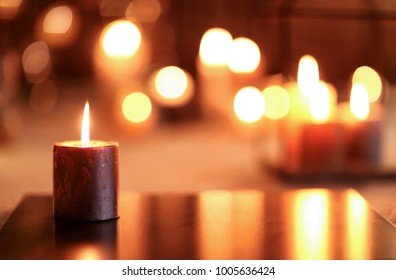 Burning candle on board indoors
