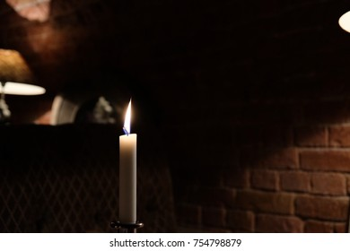 burning candle on a romantic dinner