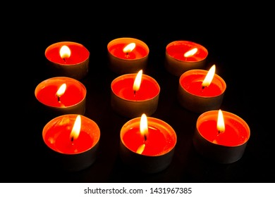 Burning candle on table in darkness, closeup with space for text.