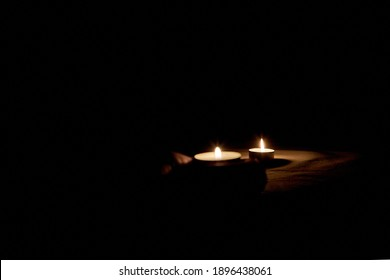 Burning candle on the table in honor of the commemoration in the dark