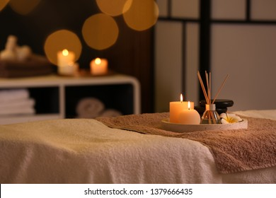 Burning candles and aromatic reed freshener on table in spa salon, space for text - Shutterstock ID 1379666435
