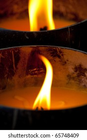 Burning Candles in Artificial Coconut Shells