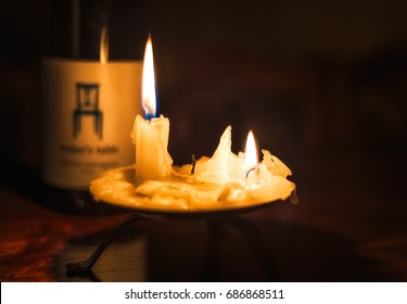 Burning Candles and a Bottle of Wine