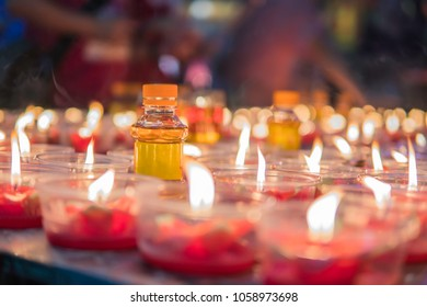 Burning candles at a Buddhist temple asian china.