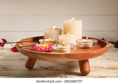 Burning candles for celebration of Divaly on tray