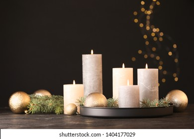 Burning candles with Christmas decoration on table. Space for text
