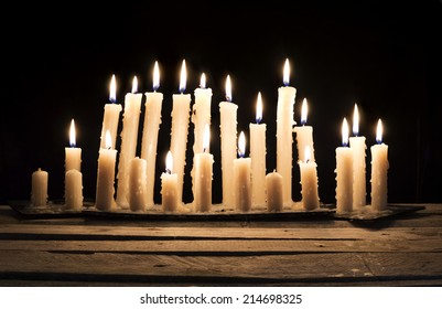Burning candles in the darkness 2