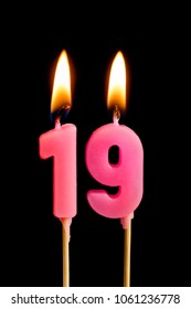 Burning candles in the form of 19 nineteen figures (numbers, dates) for cake isolated on black background. The concept of celebrating a birthday, anniversary, important date, holiday, table setting