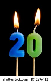 Burning candles in the form of 20 twenty figures (numbers, dates) for cake isolated on black background. The concept of celebrating a birthday, anniversary, important date, holiday
