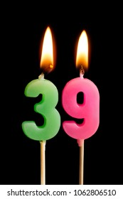Burning candles in the form of 39 thirty nine (numbers, dates) for cake isolated on black background. The concept of celebrating a birthday, anniversary, important date, holiday, table setting