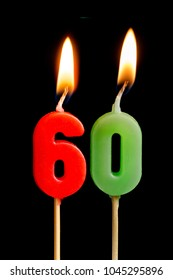 Burning candles in the form of 60 sixty figures (numbers, dates) for cake isolated on black background. The concept of celebrating a birthday, anniversary, important date, holiday