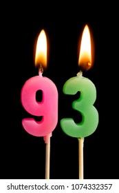 Burning candles in the form of 93 ninety three (numbers, dates) for cake isolated on black background. The concept of celebrating a birthday, anniversary, important date, holiday, table setting