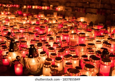 Lot of burning candles lights in dark autumn evening.