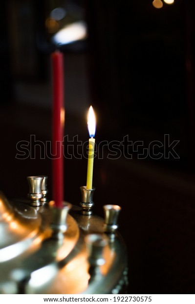 burning-candles-on-church-candlestick-60
