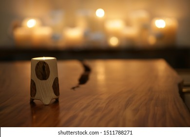 Burning candles on a nice table in the dark