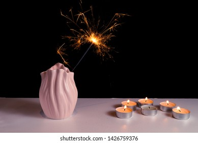 Burning candles on a white background next to the fireworks. Obon festival. Diwali festival