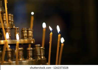 Burning candles in an orthodox church in Greece