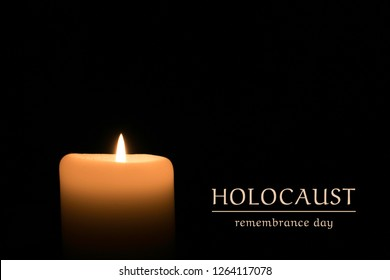 Burning candles with text Holocaust remembrance day