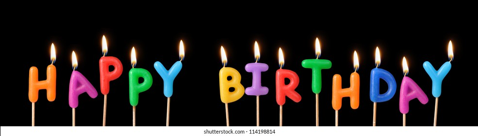 """Burning candles with the words """"Happy Birthday"""""""
