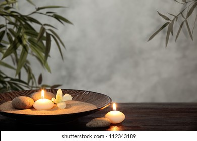Burning candles with zen stone in bowl,zen concept.