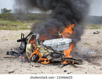 Burning car belching smoke seconds after the explosion