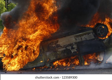 Burning car with large flames and black smoke