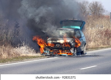 burning car on the road