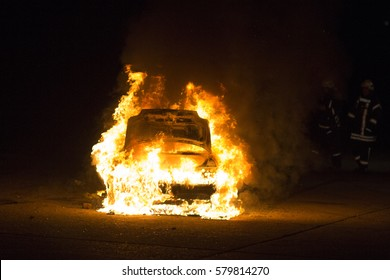 Burning car on the road in night