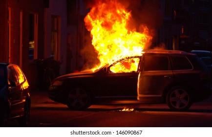 A burning car in a street