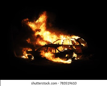 Burning cars, unrest, anti-government. Night, crime. Consequences of the collision. Car on fire isolated on black background