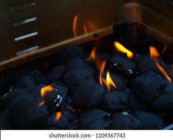 Burning charcoal on outdoor grills racket.