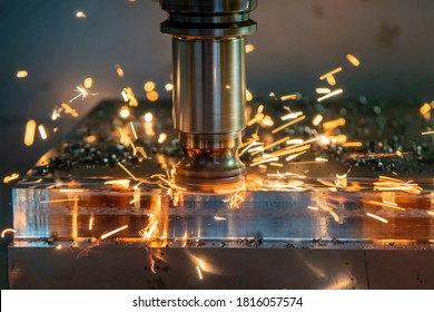The burning chip from CNC milling machine rough cutting  by index-able  end-mill tools. The index-able tool wear from machining center.