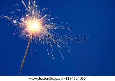 burning-christmas-sparkler-on-blue-450w-
