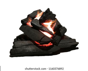 Burning coal in a barbecue pit - Isolated on white