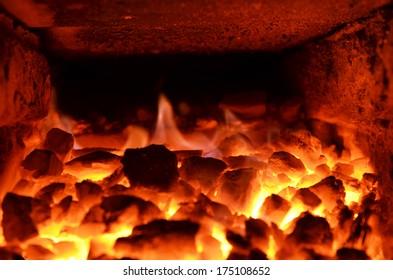 burning coal in the blast furnace