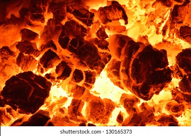 Burning coal. Close up of red hot coals glowed in the stove.
