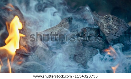 Burning coal engulfed in smoke